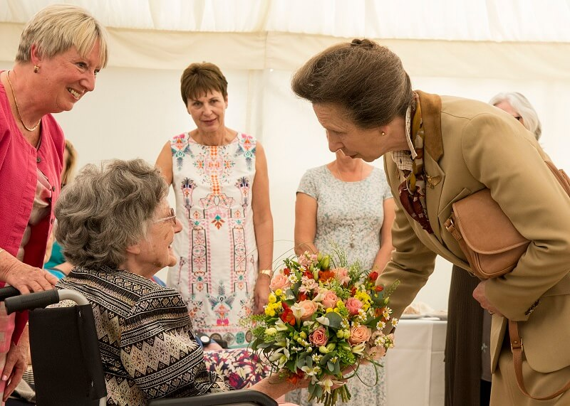 Princess Royal receives a posy from resident Joan Fowler