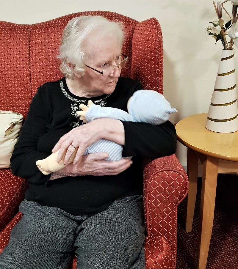 Queens Meadow resident Mrs Hogg with an empathy doll