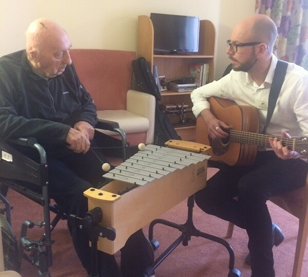 Paul Mosby (left) with music therapist Michael Angus