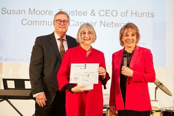 Dame Esther Rantzen awarding Susan Moore from HCCN the Make a Difference Award for the 3rd Sector Care Awards 2017.