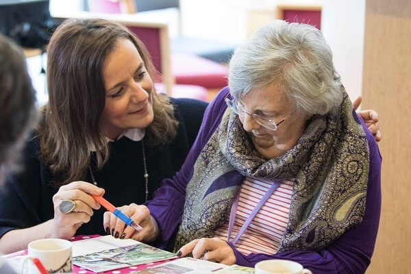 Clare Jefferies and service user at a Memory Cafe