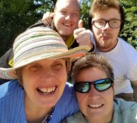 allcare community support staff and service users selfie