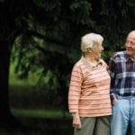 happy elderly couple stroll outside