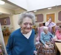 Edgeley House Care Home resident smiles to camera