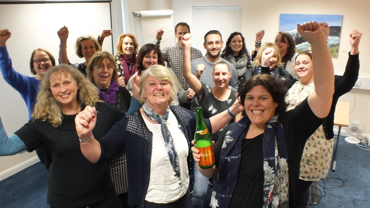 Robert Owen Communities - Domiciliary Care South Devon staff celebrating