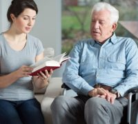 Jes care Services carer reading to service user