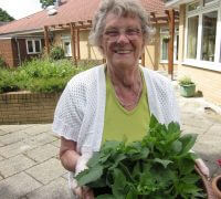 Win of Gravesend Extra Care with her plants