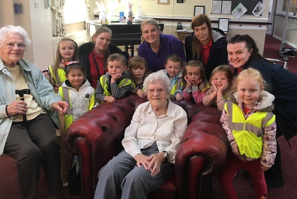 children and residents from the nursery and care home