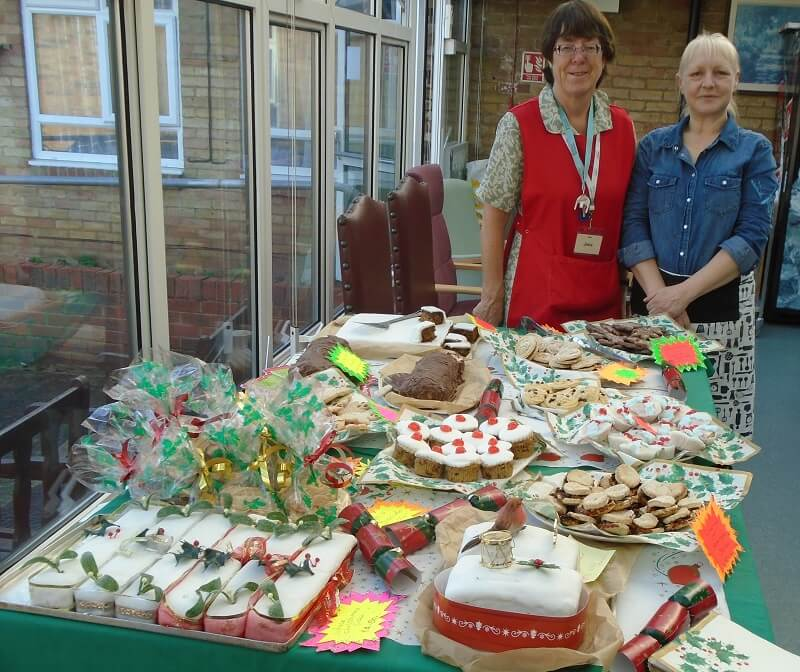 Nikki Uden and Jane Beeching at the Christmas cake sale