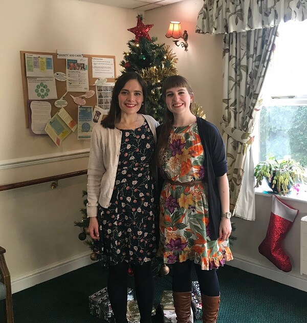 Singers Katie Hainback and Juliane Gallant from charity Lost Chord by the carehome christmas tree