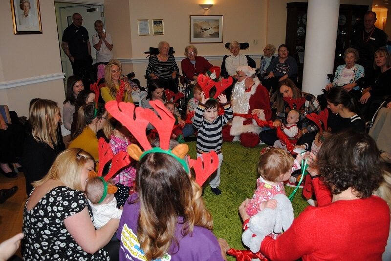 Royal Star and Garter residents enjoying the toddlers antics at Hartbeeps class