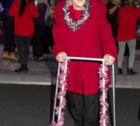 Quantum care resident with tinsel bedecked zimmer frame celebrates