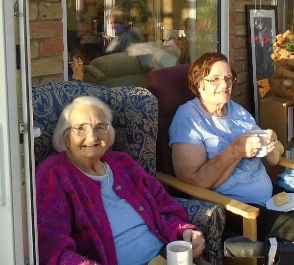 residents Barbara and Hazel enjoying a tea and some singing