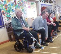 Care Home residents try out curling at the community centre