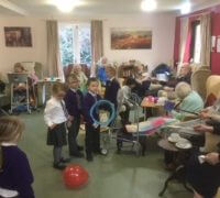 children and Alexandra House residents playing games