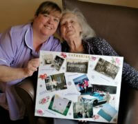 activities coordinator Michelle Park and Waverley Lodge resident Catherine Calloway with her memory board for Dignity in care