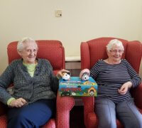 Care home residents pose with some Flumpets, the toys they are selling as part of a fundraiser