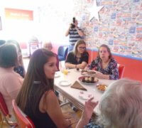YOPEY befrienders and residents at Mellish House sitting down to tea