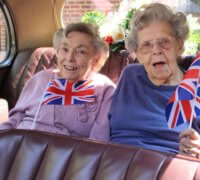 2 of the ladies from Reside care home enjoying VE day celebrations