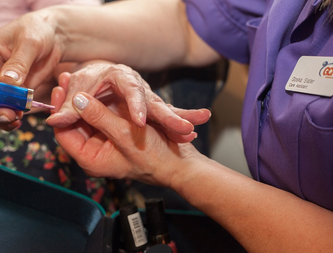 Resident Activity - nail painting at The Tudors rated Outstanding by CQC