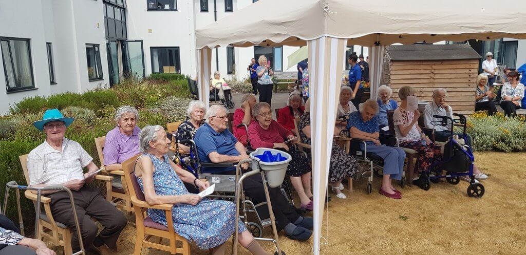guests gather to celebrate the wedding of 2 residents