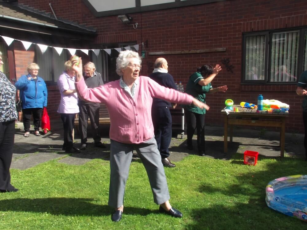 Elderly resident launches water balloon in water fight at care home