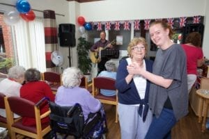 2 Crossways resident Pamela Turton dances to live entertainment with staff member Donna Maddock