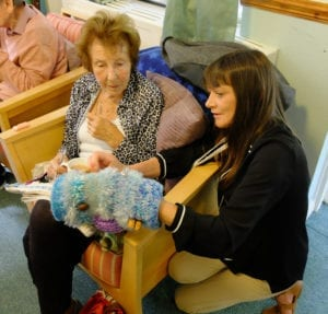 Activity coordinator Kay shows residents
