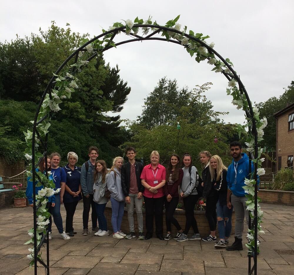 teenage volunteers help care home renovate their gardens