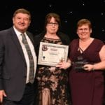 Caregiver of the year Amanda Campbell centre left Mark Darnell right Rosie Darnell