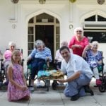 Chef Victor Albescu with residents and supporters of Edensor Care Centre who achieved bake-off victory