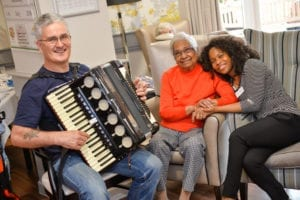 Doris Denis, resident at The Grand (centre) with musician Martyn (left) and daughter-in-law, Heike Higgins (right)