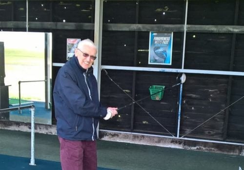 happy home care client - ian playing golf