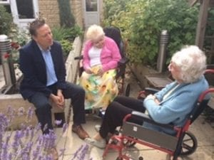Jason chats with residents in the gardens of Greenacres care home in Meltham
