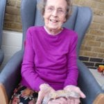 Joan Cotterill who sees the benefits of animal therapy, holding the lizard