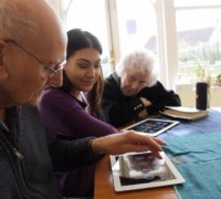 Residents at the Peggy Dodd day centre try out MindHarp - the app to help people with dementia