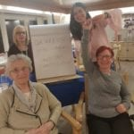 care home residents and teacher in spanish language classes