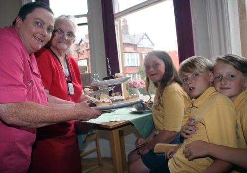 Children from wheatfield primary school enjoying themselves with St Cecilias carehome residents