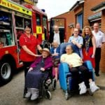 residents of eccleshare court care home open day 2018 greet the fire truck