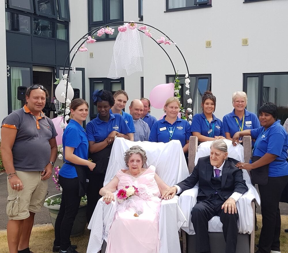 The happy couple and staff from Mayflower Court