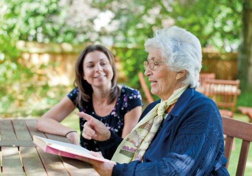 agincare live in service user reading outside