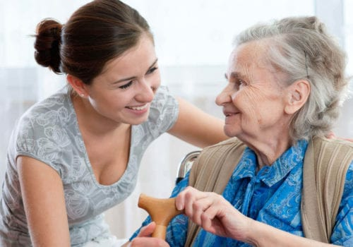 Elderly lady with young carer or family member