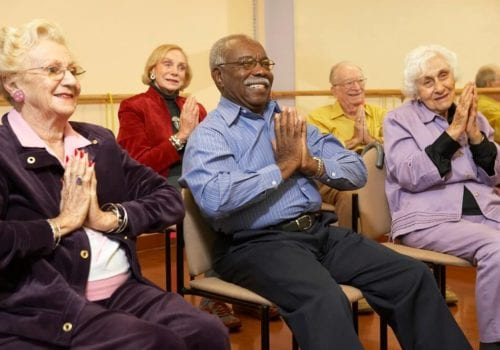 Senior adults in a stretching class keeping fit