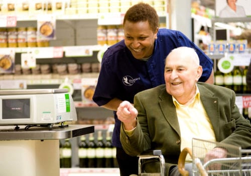Bluebird care Mid Essex carer taking service user shopping
