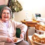Northfield House care home resident enjoying afternoon tea