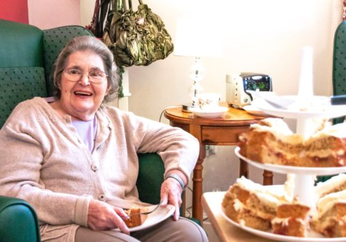 Northfield House care home resident enjoying afternoon tea