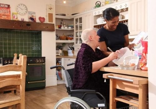 service user and carer from right at home eastbourne baking