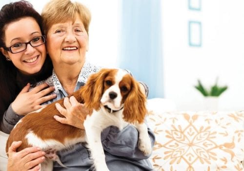 Lady hugging her dog