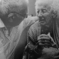 black and white image of old lady and elderly man