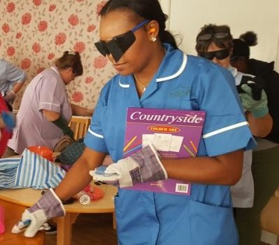 blindfolded staff member undertakes actibvities at dementia experience day